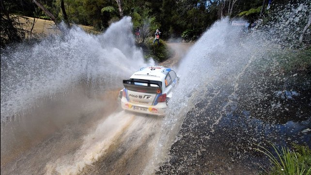 Sebastian Ogier passes through a water crossing