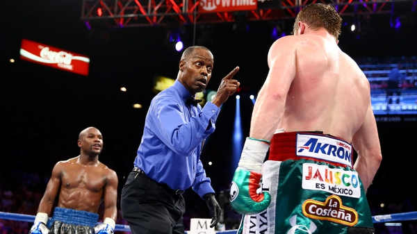 Floyd Maywether goads Canelo Alvarez as he's checked by the referee