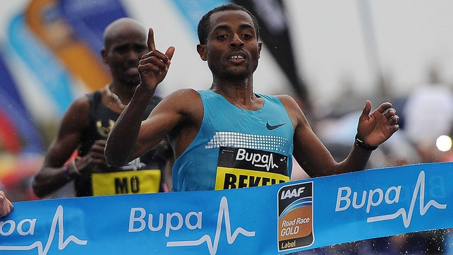 Kenenisa Bekele crosses the line closely followed by Mo Farah