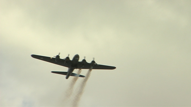 A rare World War II B17 Bomber with simulated smoke billowing from its engines