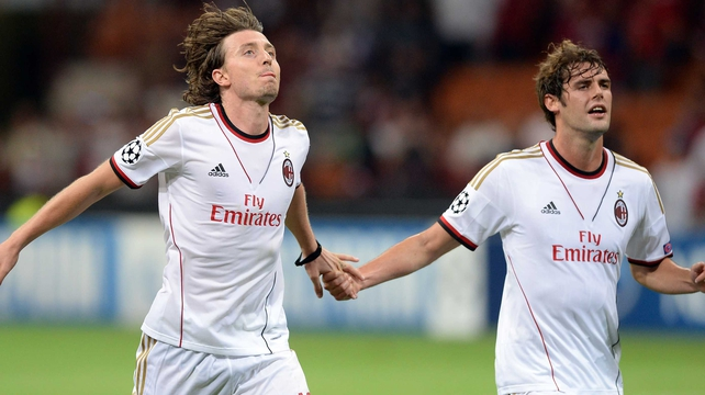 Riccardo Montolivo (l) and Andrea Poli are likely to miss Milan's tie with Celtic