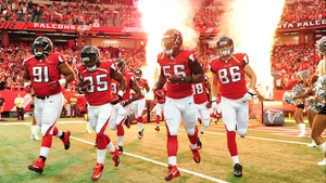 The Atlanta Falcons make a dramatic entrance ahead of their match against the St Louis Rams at the Georgia Dome