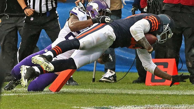 Chicago Bears Tight end Martellus Bennett crashes into the end zone at Soldier Field