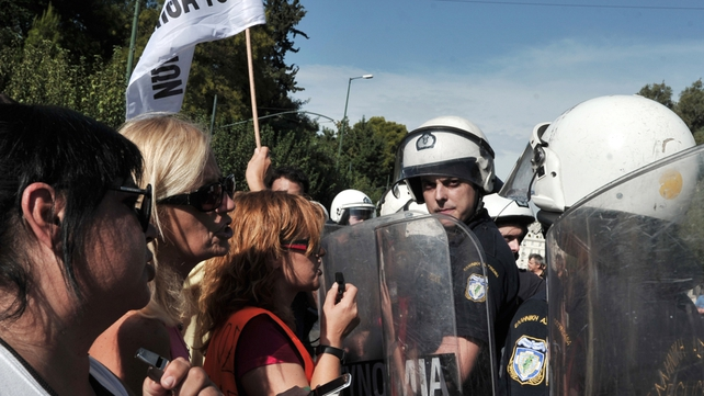 Police confront protesters during in Athens