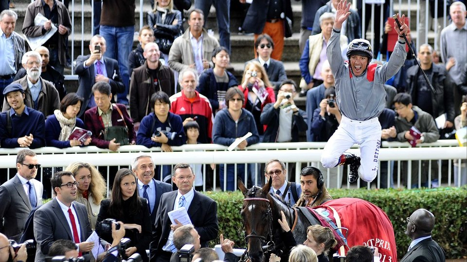 Riding high - Frankie Dettori, who failed a drugs test at Longchamp's corresponding meeting 12 months ago,    makes an exuberant flying dismount from Prix Vermeille winner Treve