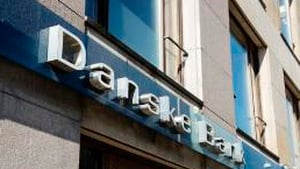 Danske Bank to write down around $1.5 billion of the value of its businesses in Finland, Northern Ireland and Estonia.