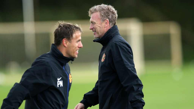 David Moyes with coach Phil Neville as Manchester United prepare for the tie