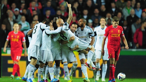 Jonjo Shelvey is mobbed following his opener