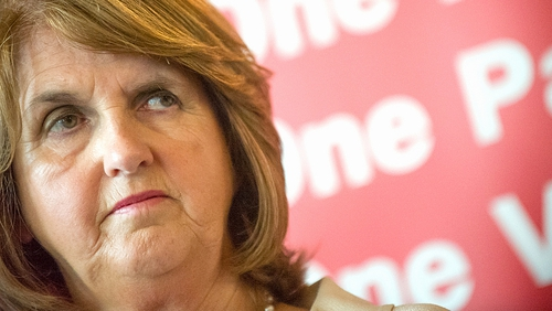 Joan Burton has expressed concern over the impact of savings required from her department