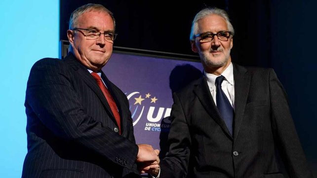 Pat McQuaid shakes hands with Brian Cooks as the election for the next president of the international cycling union looms