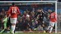 Rooney double gives United victory