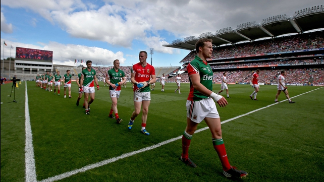 Andy Moran leads Mayo during the parade ahead of their semi-final win over Tyrone