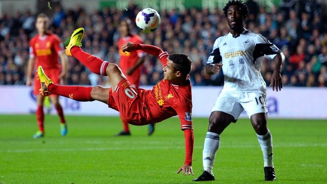 Brazilian Philippe Coutinho injured his shoulder in Liverpool's draw at Swansea on Monday night