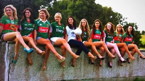 A group of random Mayo fans sitting nonchalantly on a wall; sent in by Rebecca Casey