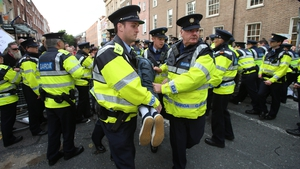Gardaí restrain a protester outside Leinster House