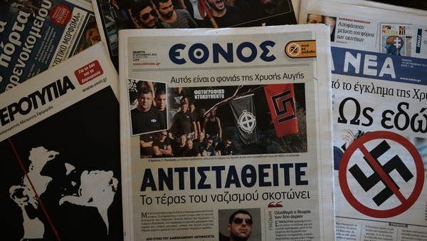 A front-page picture in centre-left daily Ethnos (C) shows the self-confessed killer at a Golden Dawn summer camp gathering