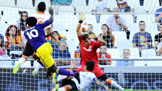 Wilfried Bony scores the opening goal against Valencia for Welsh outfit Swansea who had more Spanish players in their side than the hosts did