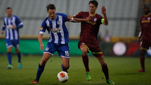 Wigan's Nick Powell and Davy de Fauw of Zulte Waregem battle for possession in in Bruges