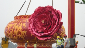 Workers install a giant vase at Tiananmen Square before China's 64th National Day