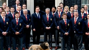 British and Irish Lions rugby player Manu Tuilagi gestures behind the head of British Prime Minister David Cameron during a photocall in Downing Street
