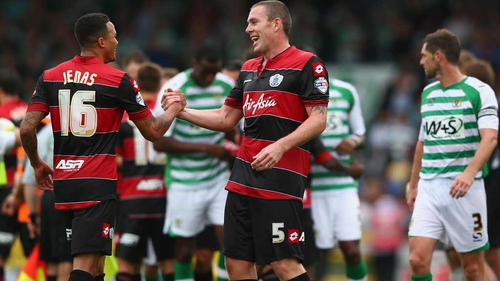 Richard Dunne and Jermiane Jenas at the end of QPR's win over Yeovil