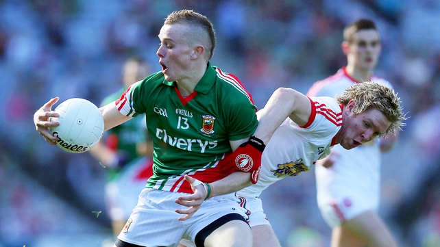 Darragh Doherty of Mayo tussels with Tyrone's Frank Burns