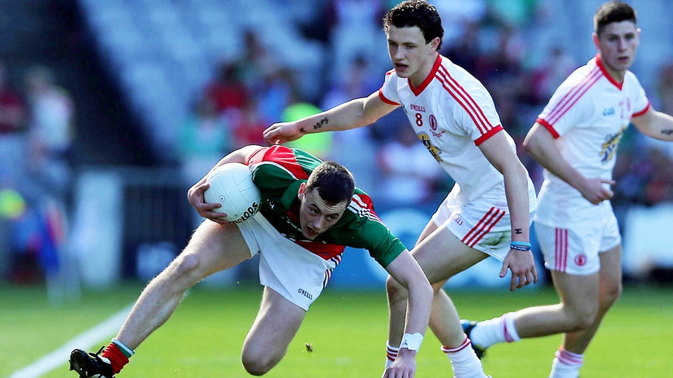 Diarmuid O'Connor tries to escape the attention of Tyrone's Ronan Nugent