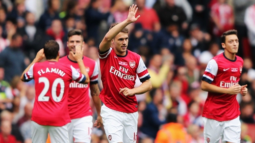 Aaron Ramsey celebrates after giving Arsenal the lead against Stoke