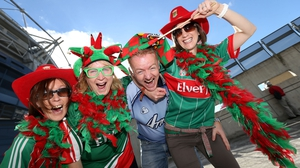A lone Dublin fan find himself amongst three ladies supporting Mayo