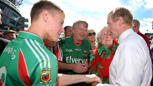 Taoiseach Enda Kenny  in conversation with Mayo fans outside Croke Park