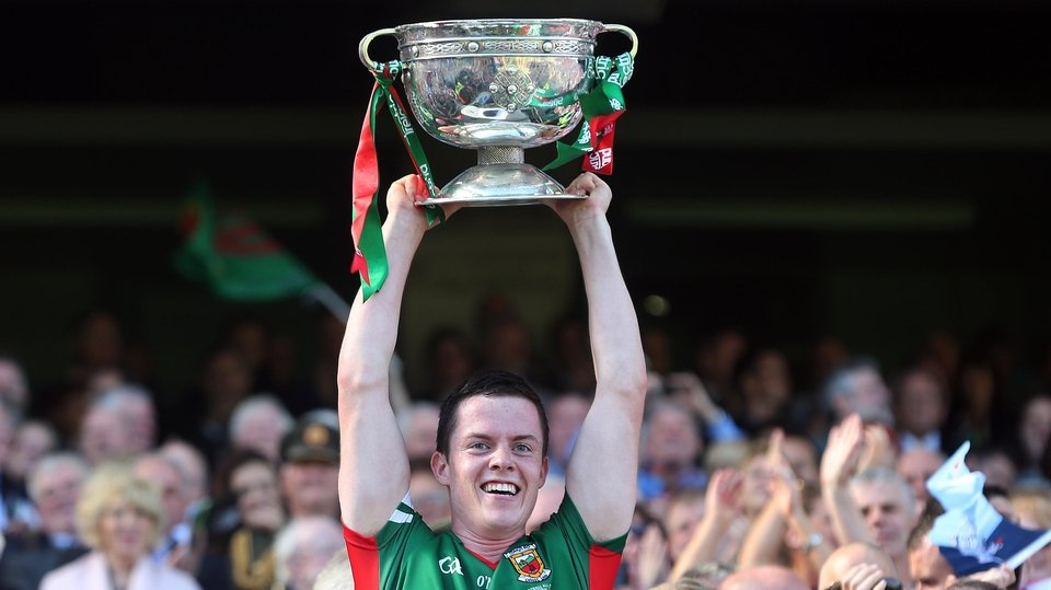 Mayo minor captain Stephen Coen lifts the cup