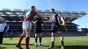 Captains Andy Moran and Stephen Cluxton exchange handshakes before the start of the game