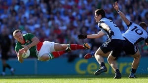 Andy Moran bounces off a tackle from Paul Flynn