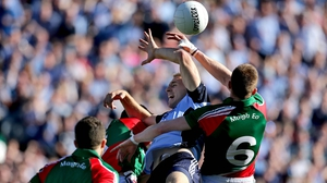 Eoghan O'Gara and Donal Vaughan battle for possession