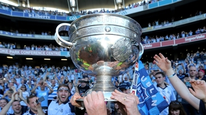 Dublin supporters get to touch the Sam Maguire trophy