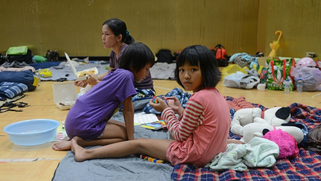Local residents stay at a detention centre in after evacuating from a mudslide area as Typhoon Usagi hit southern Taiwan
