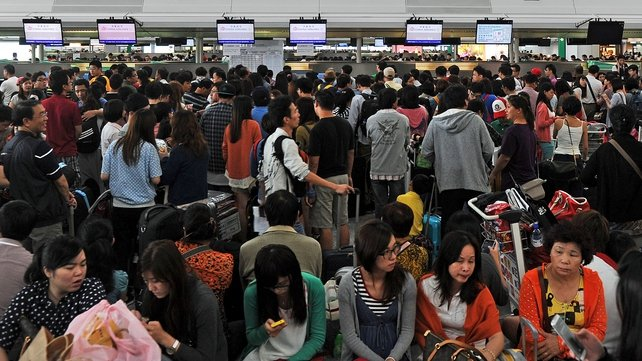 Hundreds of flights out of Hong Kong airport were cancelled