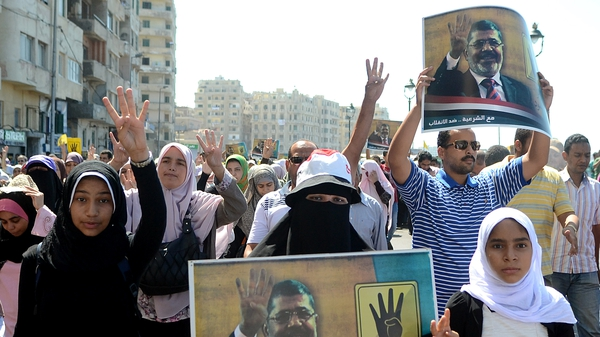Supporters of Mohammed Mursi marching in Alexandria on Friday