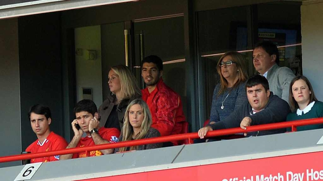 Luis Suarez watching from a hospitality box during Liverpool's defeat to Southampton on Saturday