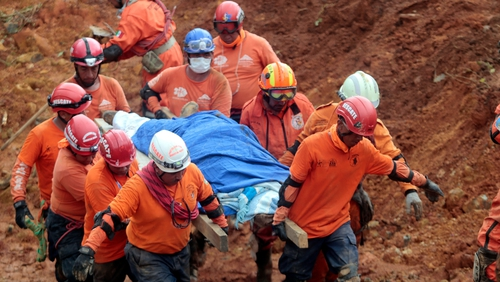 Mexican rescue team 'Topos' (Moles) personnel dig out the body a the victim of a landslide in La Pintada in Guerrero state