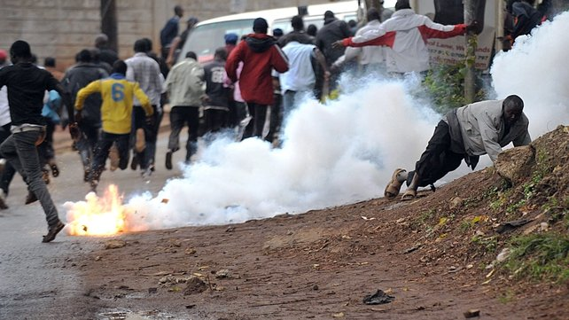 Police fire tear gas to disperse onlookers outside the perimeter around the Westgate centre