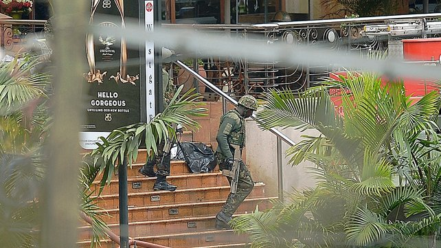 A Kenya soldier walks down steps at one entrance to the shopping centre