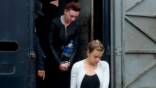 Michaella McCollum (L) and Melissa Reid arrive for their court hearing