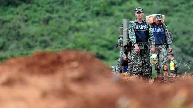 Mexican marines stand by on the site of a landslide in La Pintada