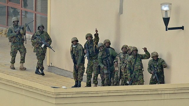 A Kenyan soldier gives a thumbs-up signal after clearing the top floor balcony and interior of the Westgate mall