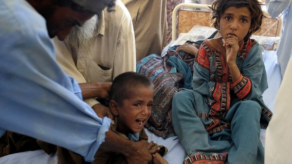 Child survivors are treated in makeshift hospital in Awaran
