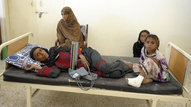 Patients wait for treatment for injuries sustained in the tremor