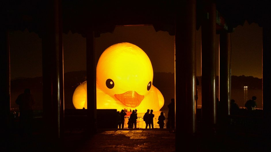 People gather to see a giant Rubber Duck by Dutch conceptual artist Florentijin Hofman at Summer Palace Kunming Lake in Beijing