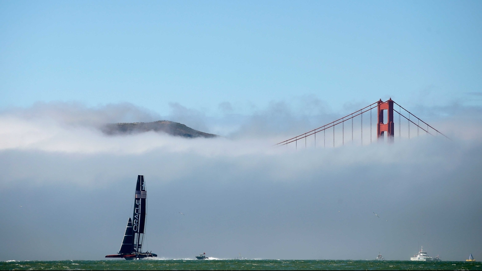 Oracle Team USA near the Golden Gate Bridge in the America's Cup finals in San Francisco, California.