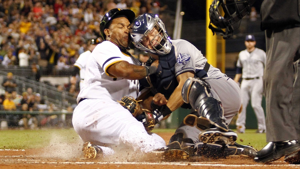 Nick Hundley of the San Diego Padres tags out Marlon Byrd of the Pittsburgh Pirates at PNC Park in Pittsburgh, Pennsylvania.